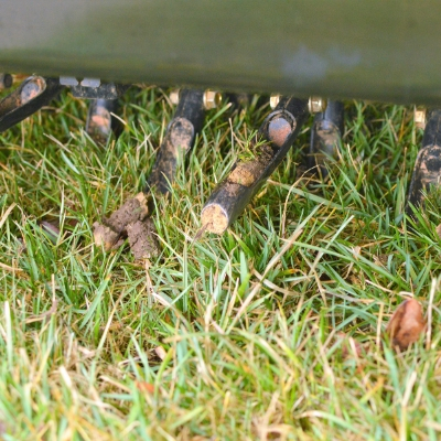 Core aeration not only controls thatch but helps alleviate soil compaction in Manchester NH